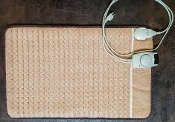 Far infra-red deep heat Mat. Warm Beigecotton cover. Tan Temperature dial - cord.