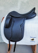 Classic lines. Black dressage saddle. Short block.